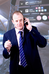Businessman making a call on his cellphone in the airport