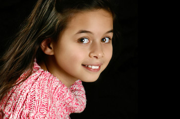 Beautiful little girl in pink jumper, lovely smile,
