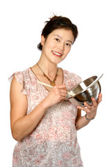 oriental female in casual clothing enjoying her baking,