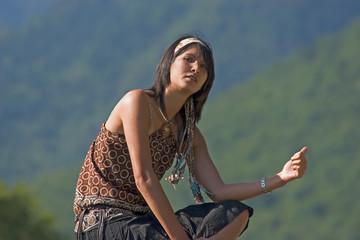 Woman making of hitch-hiking
