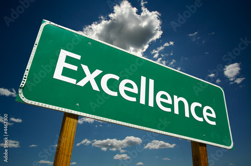 """Excellence"" Road Sign with dramatic clouds and sky."
