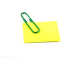 A paper clip and sticker. poster