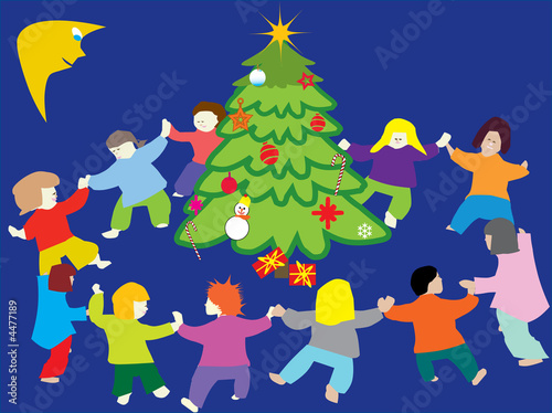 happy children dancing around christmas tree