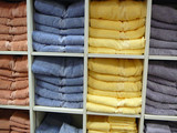 Fluffy Towels Stacked by Color poster