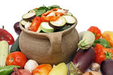 organic vegetables in a clay pot, isolated on white poster