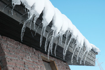 Row of icicles on a bright winter day