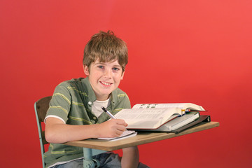 smiling child at desk in school