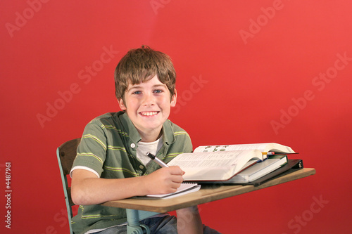 child at desk in school