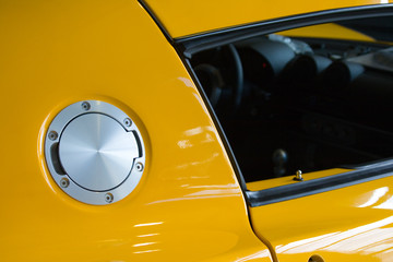 Fuel filler cover on yellow sports car