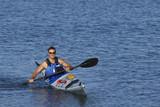 Athletic man showing off his kayaking skills poster