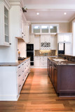 luxury kitchen with white and wood cabinets poster