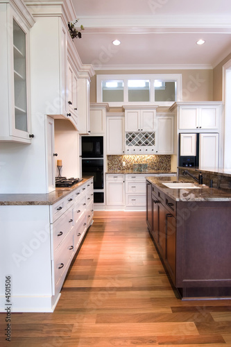 poster of luxury kitchen with white and wood cabinets
