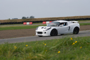 White sports car on racing circuit