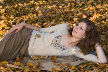 Girl on autumn leaves