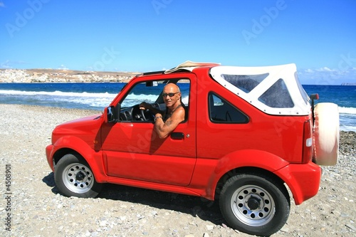 Man in red jeep