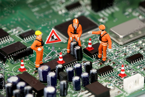 Technicians working on electronics or motherboard - 4509904