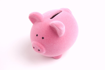 pink felt piggy bank on white background