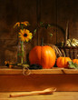 Fall still life with flowers and pumpkins