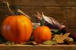 Two pumpkins on the shelf