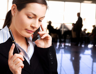 Businesswoman calls on cellphone
