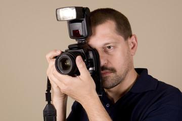 man with digital camera