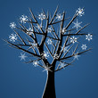 Naked tree over blue background with snow crystals
