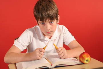 frustrated boy at school taking exam