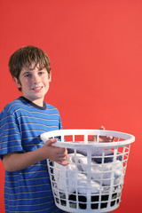 smiling young boy with laundry