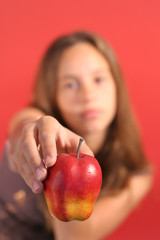 young girl with apple for teacher focus on apple