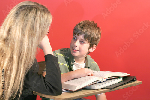mother and son doing homework smile