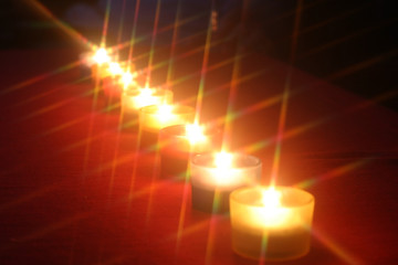Row of eight small candles (diagonal)..