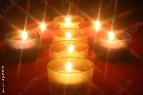 Candles arranged in the shape of an arrow..