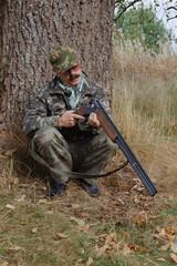 Hunter examines the gun