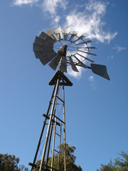 vertical windmill with blue sky