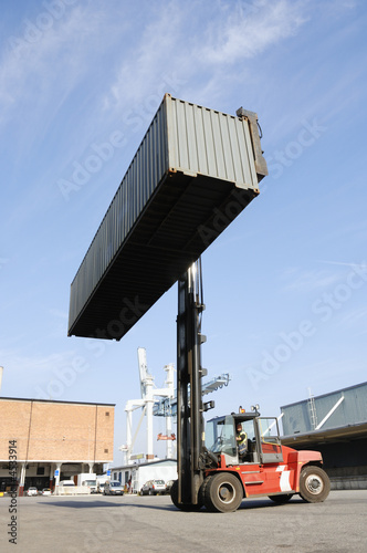 large forklift truck and container