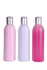 Three colourful bottles isolated on white background