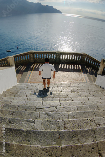 Atrani coast of Amalfi man going downstairs of church Bireto