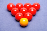 Snooker balls arranged in a triangle - yellow is odd one out poster