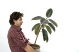 Man carrying a plant poster