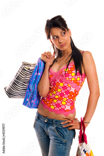 Young brunette girl with shopping bags