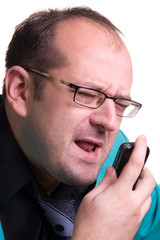 Frustrated manager wearing glasses yelling at the mobile phone