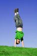 fit healthy child playing handstand or cartwheel