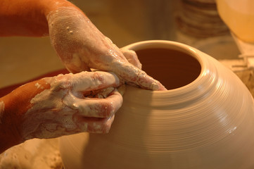Potter's hands creating new ceramic vase
