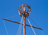 Top of mast for sailor to observe horizon over blue sky poster