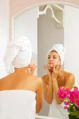 Beautiful girl massages her face