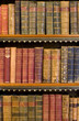 Lots of old books on a bookshelf in library.
