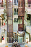 elevators in a multilevel shopping mall poster