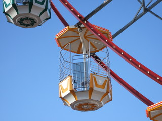 A Carriage on a Big Wheel at a Fun Fair.