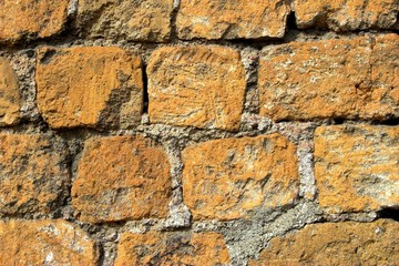 Old orange and grey brick wall, texture and background