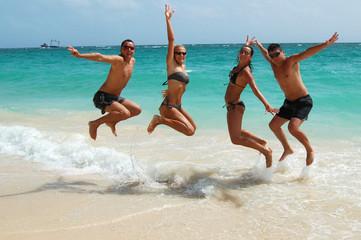 People jumping in the ocean